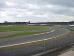 Part of the panoramic view from the Brooklands suite. This is the entrance to the Luffield loop (Luffield grandstand in background. Click for entire gallery.