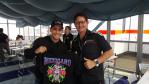 Guide Matt with our sponsored team's rider Luis Salom showing off the new merchandise